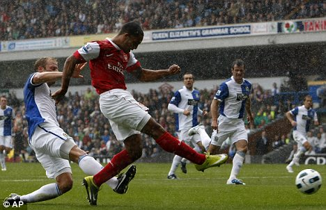 Walcott boots the ball in